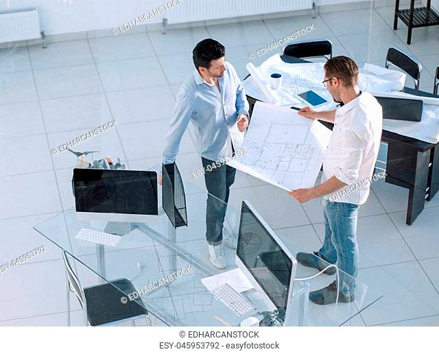top view. two employees standing in a creative office.photo with copy space