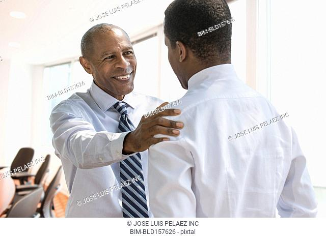 Black businessmen talking in office