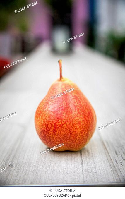 Pear standing on table