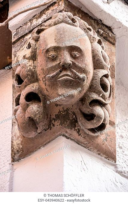 Stone head on the corner of an old building