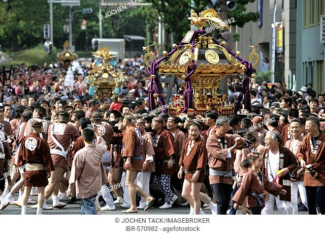 Japan, Tokyo: Shrine festival, called Matsuri. The Shinto shrines are carried through the streets of the Shinto temple district