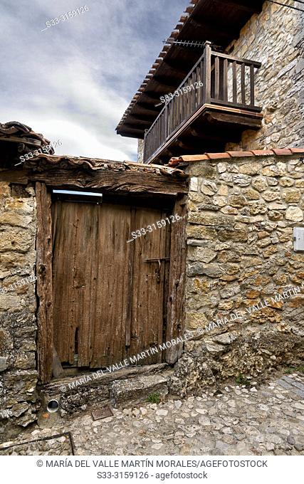 Old wooden door and balcony in Calatañazor. Soria. Castilla León. Spain. Europe