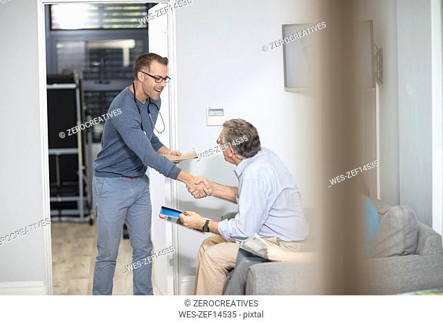 Doctor shaking hands with patient in medical practice