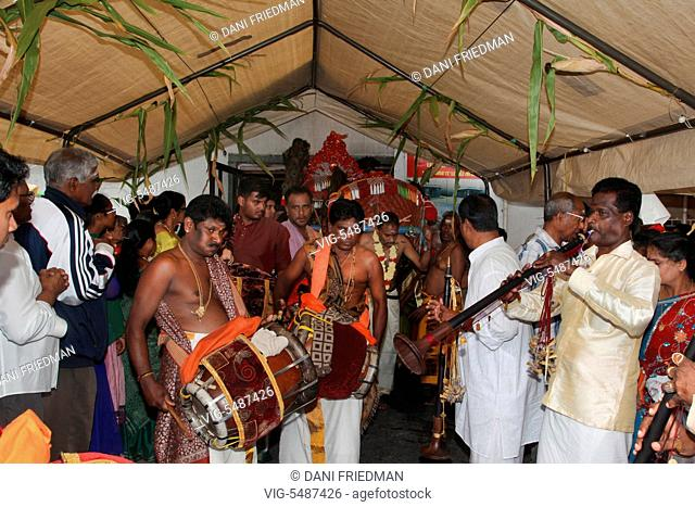 CANADA, SCARBOROUGH, 11.09.2015, Tamil Hindu musicians playing the Thavil and Naathaswaram lead the procession during the Chariot festival of Kandaswamy (Lord...