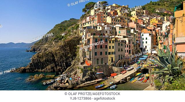 Colorful historical houses in the small coastal village Riomaggiore at the Ligurian coast, North West Italy