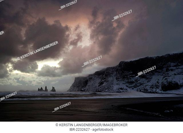 Stormy sunset on the beach at Vík, Reynisdrangar Pinnacles, South Iceland, Iceland, Europe