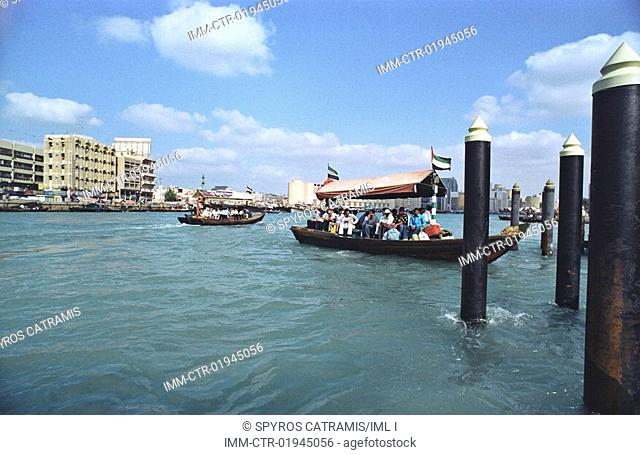 Locals take the Abra, a water taxi that goes back and forth the Creek, connecting Deira and Bur Dubai. They approach Bur Dubai Old Souk Station