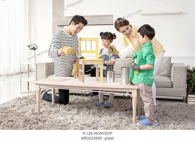 Harmonious family working together with tools