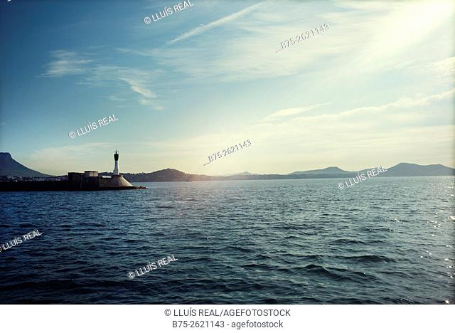 Light house in the entrance of Le Port de Toulon in the early morning. Large military harbor on the Mediterranean coast, French naval base