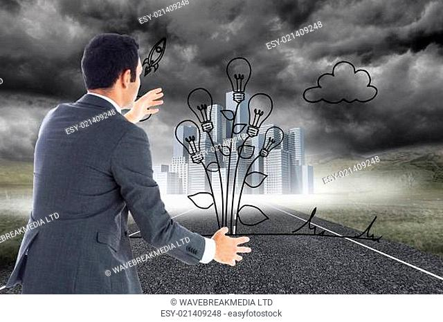Composite image of businessman catching