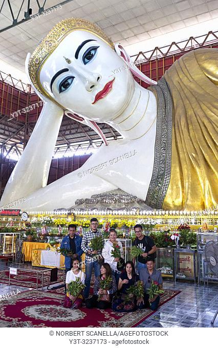 Myanmar (formerly Burma). Yangon (Rangoon). The Kyaukhtatgyi Pagoda is home to a large 70 meter long lying Buddha. His feet plants bear the 108 sacred marks...