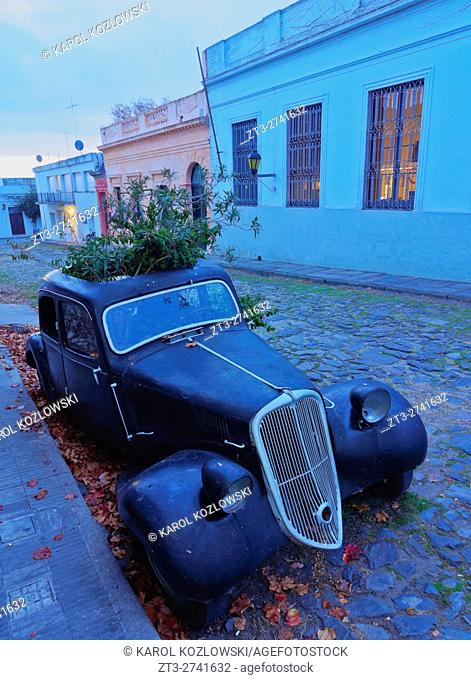 Uruguay, Colonia Department, Colonia del Sacramento, Vintage car on the cobblestone lane of the historic quarter