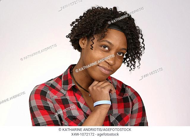 Young African-American woman posing for portrait