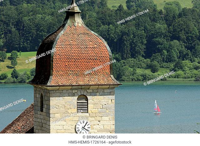 France, Doubs, Les Grangettes church dated 17th century, Comtois Imperial steeple, Saint Point lake, sailboat