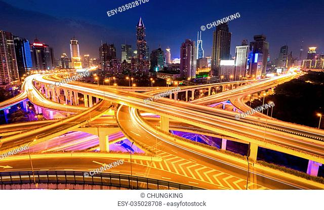a panoramic view of city interchange overpass at night in shanghai