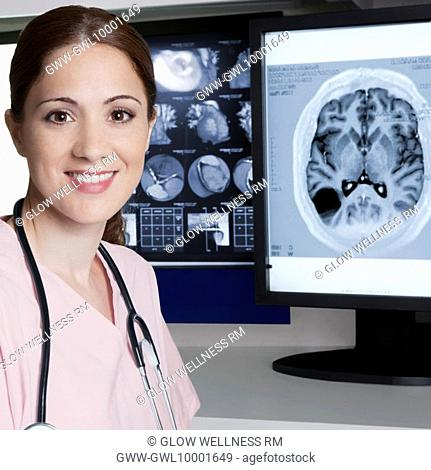 Portrait of a female doctor with MRI report