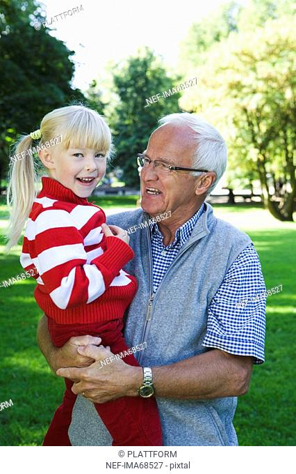 A girl with her grandfather in the park Sweden