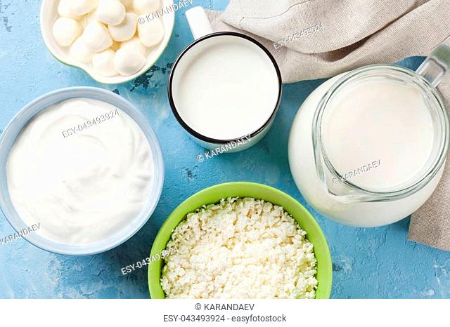 Dairy products on stone table. Sour cream, milk, cheese, yogurt and curd. Top view