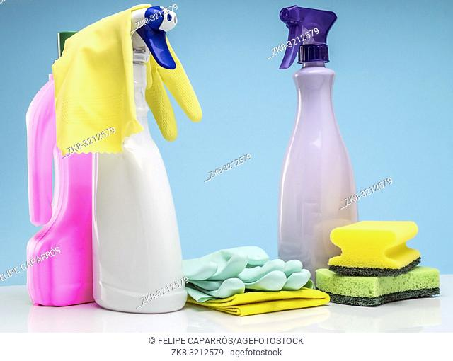 Domestic cleaning utensils insulated on a blue background
