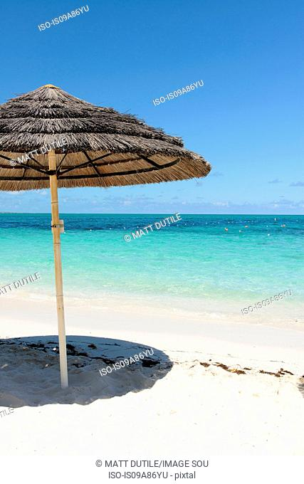 Parasol on beach, Grace Bay, Providenciales, Turks and Caicos, Caribbean