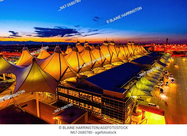 The Jeppesen Terminal, Denver International Airport, Denver, Colorado USA (with the Rocky Mountains on the left). The tent like roof is meant to resemble...