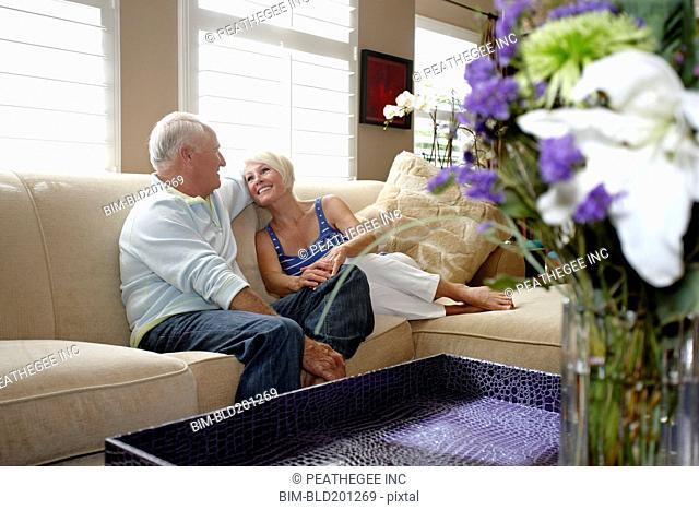 Caucasian couple sitting on sofa