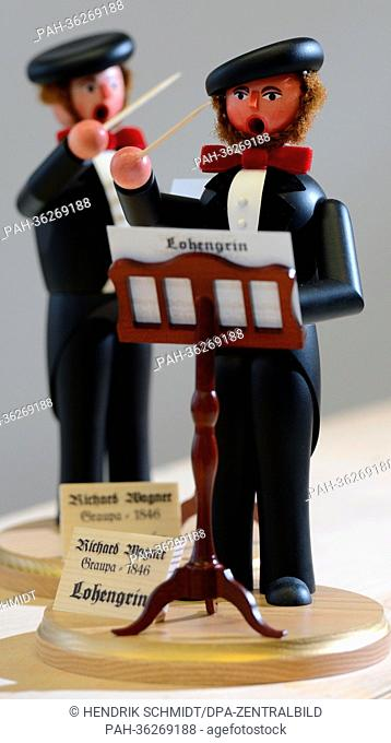 Wooden incense burning figures by wooden toy maker Dirk Beyer that resemble Richard Wagner are on display in his workshop in Seiffen, Saxony, 09 January 2013