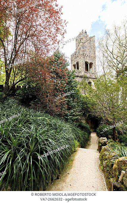 Old mystical tower of Romanesque Gothic and Renaissance style inside the park Quinta da Regaleira Sintra Portugal Europe