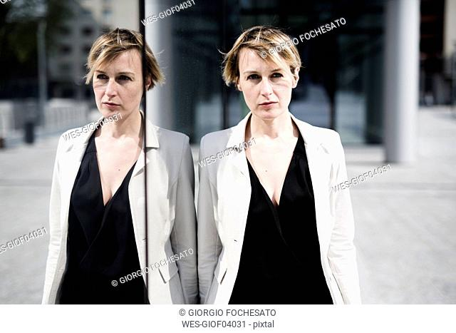 Businesswoman with her mirror image