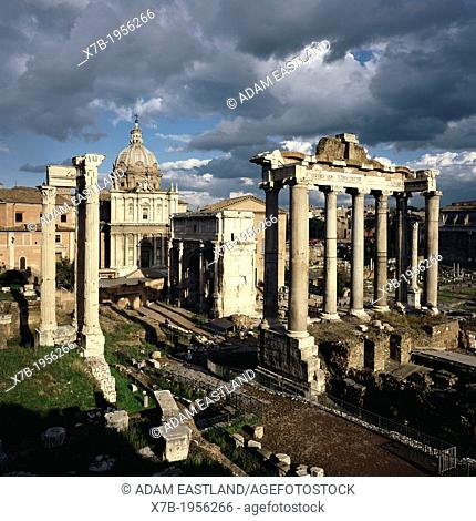 Rome. Italy. The Roman Forum (Foro Romano). Foreground L-R, the Temple of Vespasian, the Church of Santi Luca e Martina, Arch of Septimius Severus and the...