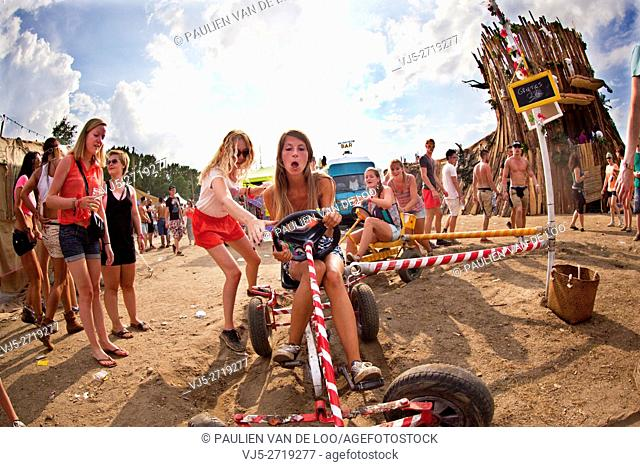 Roermond, Netherlands, girls are having fun playing with toys from their childhood