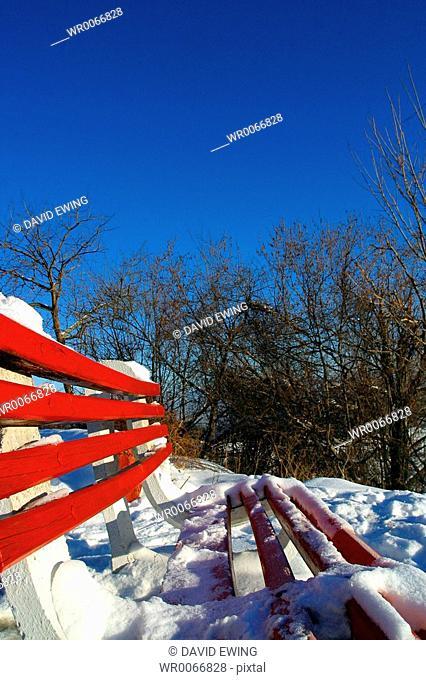 A bench covered in snow, Brasov, Transylvania, Romania