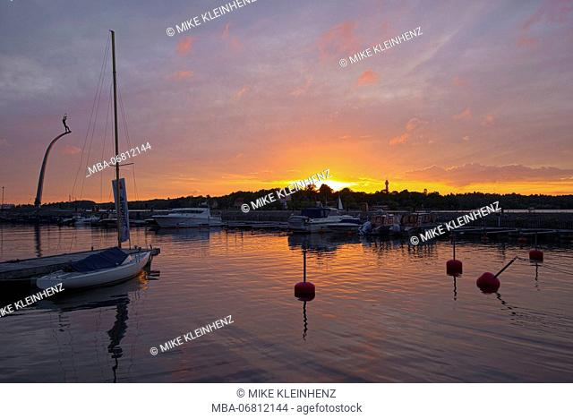 Sweden, Stockholm, sundown in the small harbour of Nacka beach