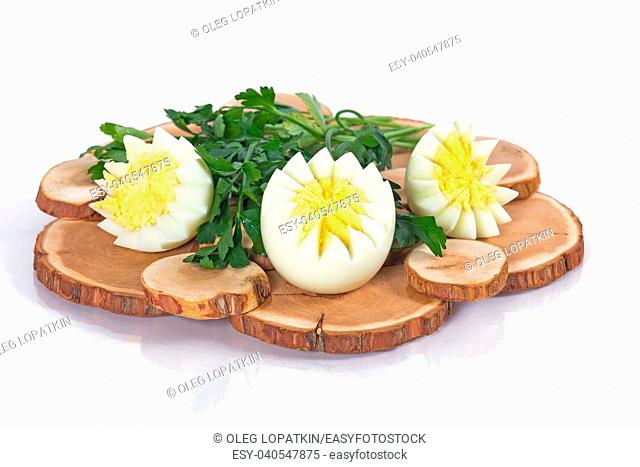 Egg and parsley on a white background