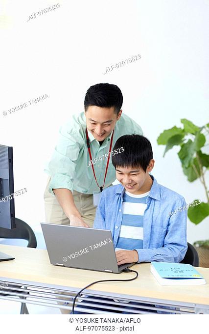 Japanese teenager studying programming