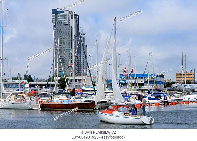 Sailboat entering the marina