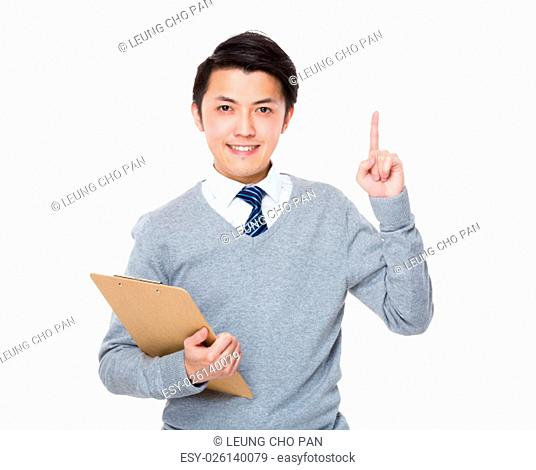 Asian Businessman hold with clipboard and finger up