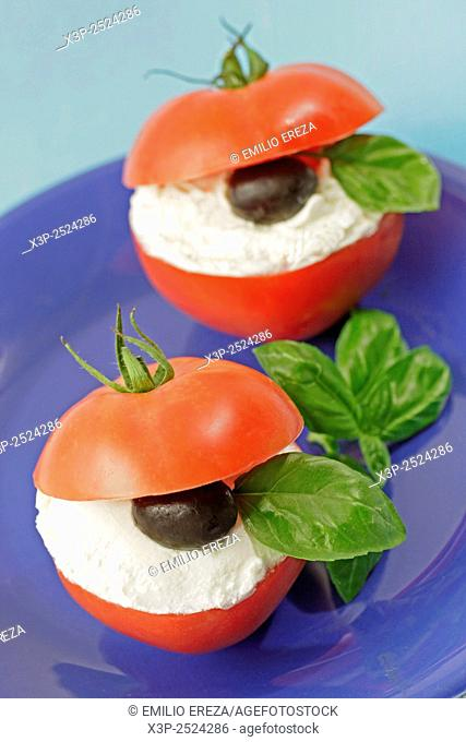 Stuffed tomatoes with soft cheese