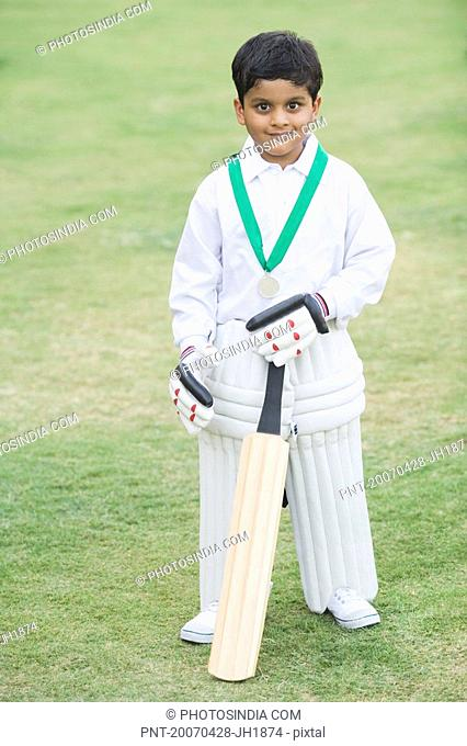 Cricketer standing in a cricket field