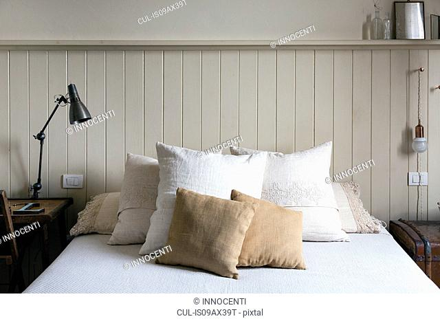 Double bed with pillows and cushions