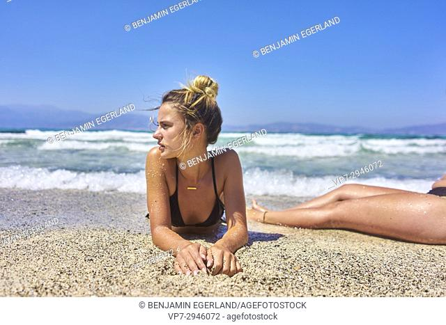 young woman laying at the beach. Dutch ethnicity. At holiday destination Chrissi Island, Crete, Greece