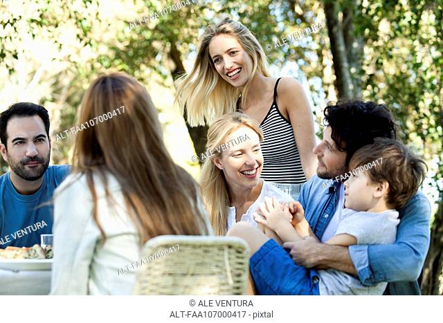 Friends and family enjoying meal together outdoors