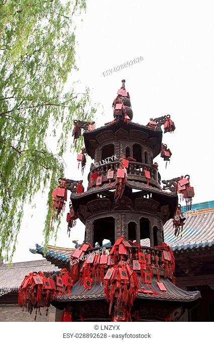 incense burner covered with red wooden sign, in a temple, China