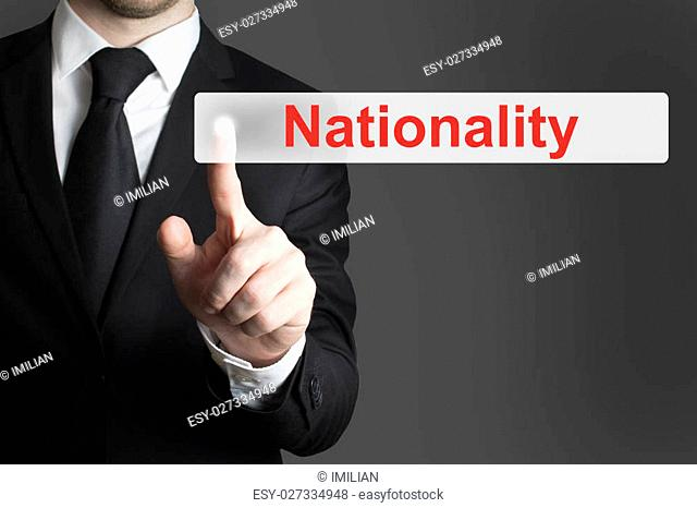 businessman in black suit pushing button nationality