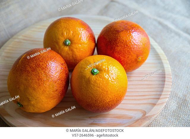 Four blood oranges. Still life