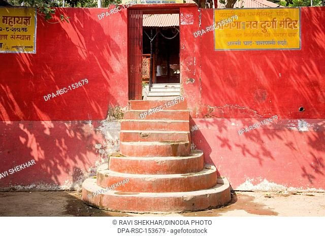 Red color wall and staircase of the temple ; Assi Ghat ; Varanasi ; Uttar Pradesh ; India