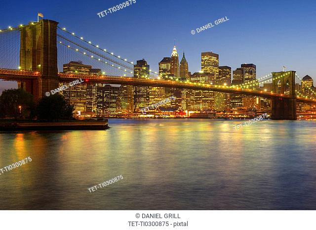 Brooklyn Bridge and Jersey City buildings at night
