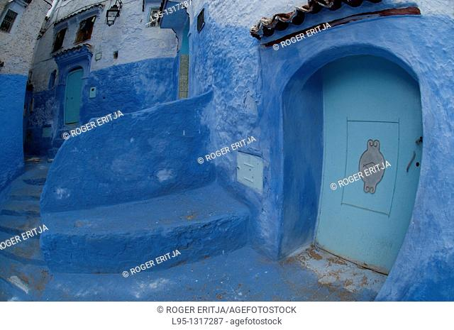 Entrance doors in Chaouen, Morocco, also known as 'The Blue Village' due to the pigment traditionally embedded in the plaster