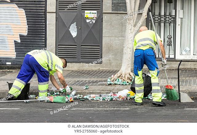 Council workers clearing up beer cans and bottles outside U. D. Las Palmas football stadium during game. Las Palmas, Gran Canaria, Canary Islands, Spain
