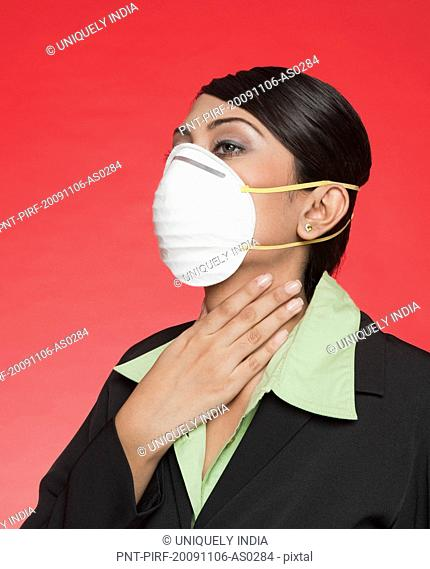 Businesswoman wearing a pollution mask